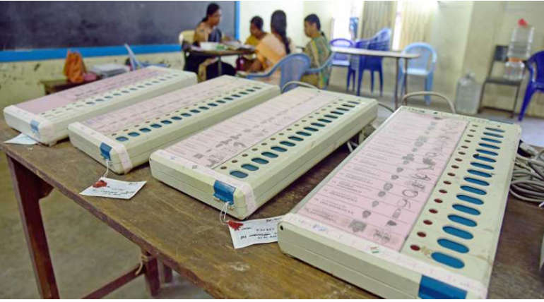 Electronic Voting Machine inside a TN Poll station. Depicted Image